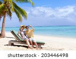 young couple at the beach... | Shutterstock . vector #203446498