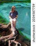 Woman At Beautiful Geyser Lake...