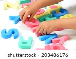 child's hands playing with... | Shutterstock . vector #203486176