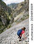 Woman Hiker Going Down Hill...
