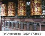 Golden Prayer Wheels With...
