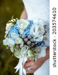 the bride holds wedding bouquet | Shutterstock . vector #203574610