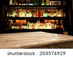 Stock photo wooden table and bar space 203576929