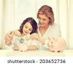 Mother And Daughter With Piggy...