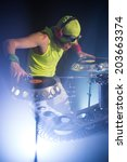 dj in a bright shirt plays on... | Shutterstock . vector #203663374