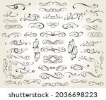 set of calligraphic decorative... | Shutterstock .eps vector #2036698223