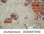 An Old Red Brick Wall With...