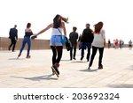 rollerblading on the beach.... | Shutterstock . vector #203692324