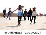 rollerblading on the beach.... | Shutterstock . vector #203692324