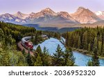 The train goes along the mountain river. Mountain forest train ride. Train in mountain forest. Train in mountains