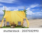 A Yellow Tent With Two Chairs...