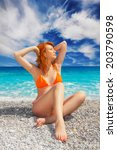 Small photo of Woman sunbathing on Lalaria Beach, Skiathos Island, Greece