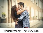 kiss of couple on street of... | Shutterstock . vector #203827438