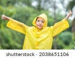 A Boy Wearing A Yellow Raincoat....