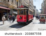 Small photo of ISTANBUL - APRIL 29, 2014: Traditional red tram trundled along Istiklal Caddesi for 1.64 km (1 mile) connecting Taksim Square with Galatasaray and Tunel Square