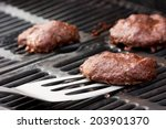 burgers on the grill | Shutterstock . vector #203901370