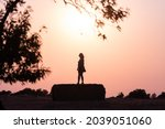 Silhouette Of A Woman In The...