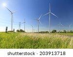 wind turbine on blue sky | Shutterstock . vector #203913718