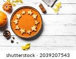 Pumpkin Pie On White Wooden...