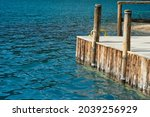 A wooden bridge extends into...