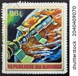 Small photo of Republic of Burundi - CIRCA 1972: Postage stamp 'Space Rocket Soyuz 11' printed in Republic of Burundi. Series: 'Exploration of Space', 1972