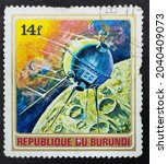 Small photo of Republic of Burundi - CIRCA 1972: Postage stamp 'First spacecraft Luna 1' printed in Republic of Burundi. Series: 'Exploration of Space', 1972