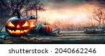 Halloween Pumpkins On Table...