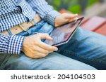 the man uses a digital tablet... | Shutterstock . vector #204104503