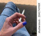 macro photo cigarette in hand.... | Shutterstock . vector #2041749989