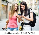 two girls using smartphone... | Shutterstock . vector #204177298