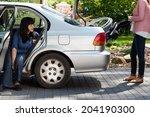 girl taking wheelchair from car ... | Shutterstock . vector #204190300