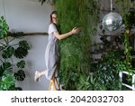 Happy Young Woman Florist In...