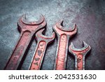 vintage wrenches covered with... | Shutterstock . vector #2042531630