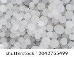 sodium hydroxide beads or lye   ... | Shutterstock . vector #2042755499