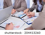 midsection of business people... | Shutterstock . vector #204413260