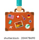 briefcase with stickers in hand.... | Shutterstock .eps vector #204478690