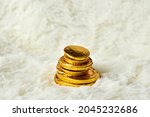 Gold Coins On Creamy White Wool ...