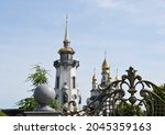 Christian church cross in high steeple tower for prayer. Photography consisting of beautiful church with cross on steeple tower to sincere prayer. Cross steeple tower is church prayer over clear sky.