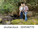 two hikers standing in mountain ... | Shutterstock . vector #204548770