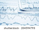 showing business report | Shutterstock . vector #204594793