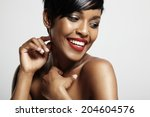 smiling happy black woman | Shutterstock . vector #204604576