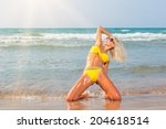 beautiful woman on the beach.... | Shutterstock . vector #204618514