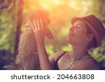woman with an adorable dog | Shutterstock . vector #204663808