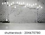 damaged brick wall with bulbs | Shutterstock . vector #204670780