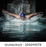 Young Man In Swimming Cap And...