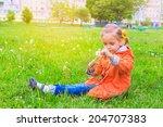 girl on grass with dandelion... | Shutterstock . vector #204707383