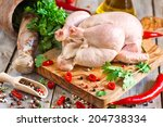 Raw Chicken With Spices And...