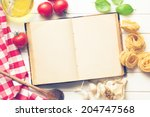 the blank recipe book and fresh ingredients - stock photo