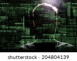 silhouette of a hacker uses a... | Shutterstock . vector #204804139