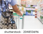 woman with shopping cart in... | Shutterstock . vector #204853696